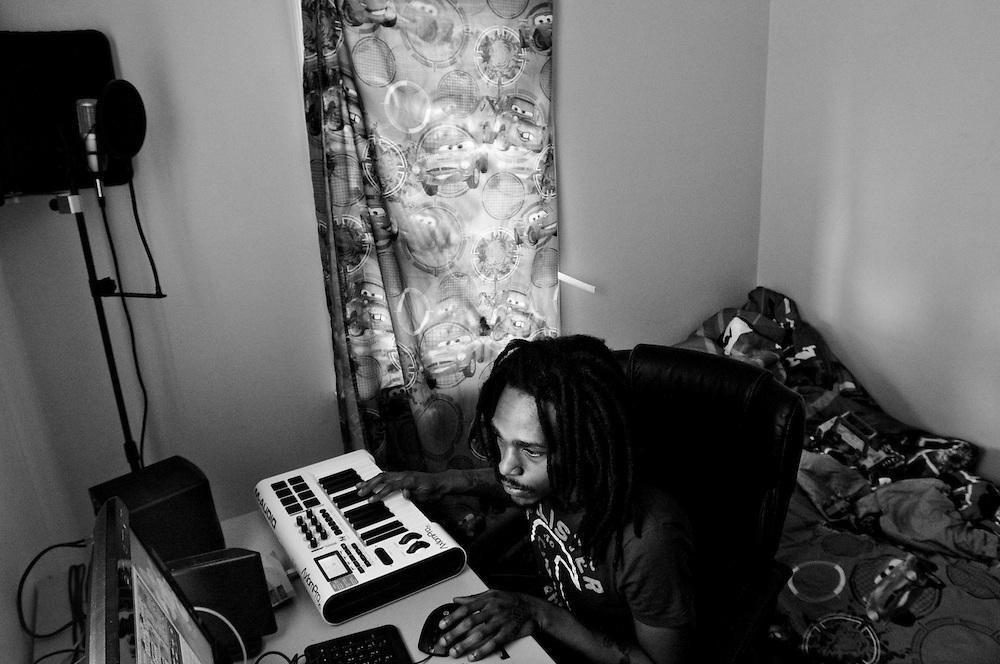 A young producer lays down a beat from his ad hoc home studio in Gary, Indiana. The home grown rap music scene is a growing trend among the city's youth. The songs reflect the often hard scrabble life of the artists. (© William B. Plowman/Redux)
