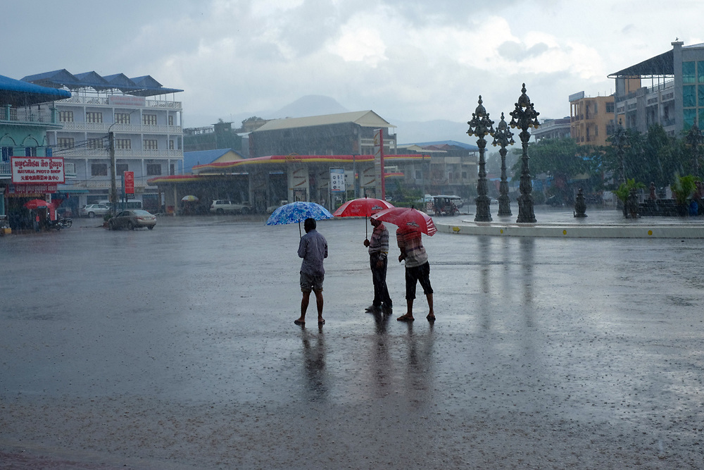 Taxi drivers are waiting for clients under a monsoon rain in Kampot, Cambodia.<br /> Photo by Lorenz Berna