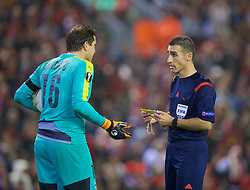 LIVERPOOL, ENGLAND - Thursday, November 26, 2015: Referee Alon Yefet from Israel shows a yellow card to FC Girondins de Bordeaux's goalkeeper Cedric Carrasco after awarding a penalty to Liverpool during the UEFA Europa League Group Stage Group B match at Anfield. (Pic by David Rawcliffe/Propaganda)