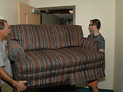 Ohio University graduate student Guy Klein (right) and Don Toy move a couch into Adams Hall for a friend Sunday afternoon.