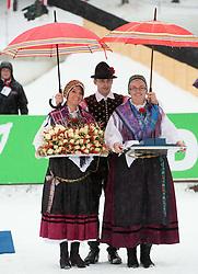 Folk costume at flower ceremony  during Men 12,5 km Pursuit competition of the e.on IBU Biathlon World Cup on Thursday, December 15, 2012 in Pokljuka, Slovenia. The third e.on IBU World Cup stage is taking place in Rudno polje - Pokljuka, Slovenia until Sunday December 16, 2012. (Photo By Vid Ponikvar / Sportida.com)
