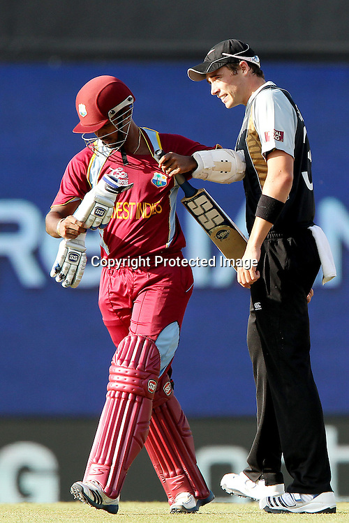 Tim Southee clashes with Denesh Ramdin of The West Indies as he departs during the ICC World Twenty20 Super Eights match between The West Indies and New Zealand held at the  Pallekele Stadium in Kandy, Sri Lanka on the 1st October 2012<br /> <br /> Photo by Ron Gaunt/SPORTZPICS/PHOTOSPORT