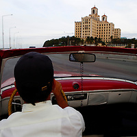 Central America, Cuba, Havana. Classic Car and Hotel Nacional in Havana.