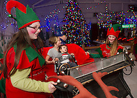Santa's elves Holly and Mint Nugget take the reins for Hayley Cochrane and her cousin Zachary Martin's sleigh ride to the North Pole at Christmas Village on Thursday evening.   (Karen Bobotas/for the Laconia Daily Sun)