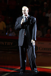 03 February 2007: Doug Collins at center court addresses the crowd at half-time.  The playing surface was dedicated in his name during a pre-game ceremony. In what is locally referred to as the War on Seventy Four, the Bradley Braves defeated the Illinois State University Redbirds 70-62 on Doug Collins Court inside Redbird Arena in Normal Illinois.