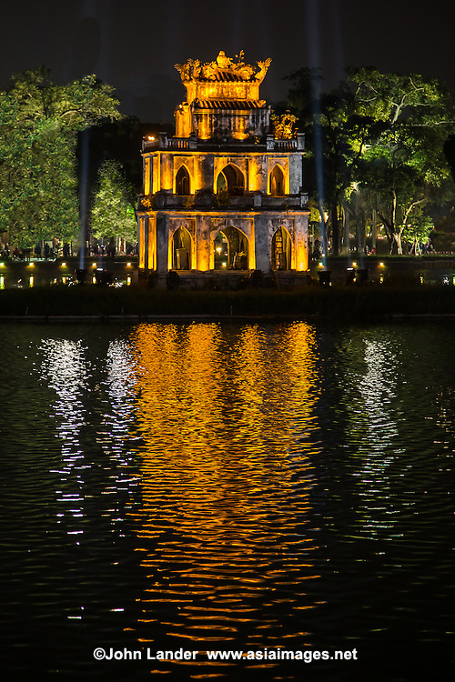 """Turtle Pagoda, sitting in the middle of Hoan Kiem Lake or """"Lake of the Returned Sword"""" is in the historical center of Hanoi, the capital of Vietnam. The lake is one of the most scenic spots in the city and serves as a focal point for its public life."""