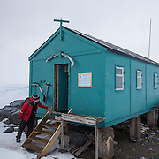 Jonathan Shackleton peers into a former transit hut now a British museum in Antarctica.