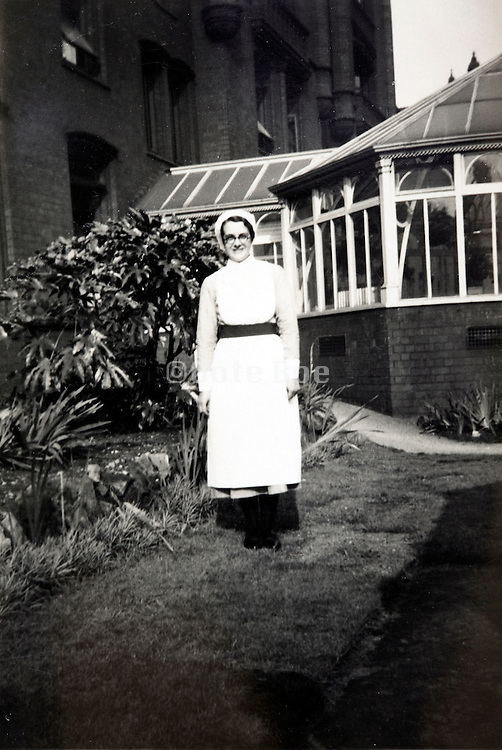full length portrait of a nurse 1900s England