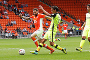 Exete's Craig Woodman just takes it off the toe of Blackpool's Mark Yeates as he goes through on goal during the EFL Sky Bet League 2 match between Blackpool and Exeter City at Bloomfield Road, Blackpool, England on 6 August 2016. Photo by Craig Galloway.