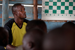 Robert Katende, the chess coach of Phiona Mutesi, a 14-year-old chess prodigy, at the Agape Church inside Katwe, the largest slum in Kampala, Uganda, Dec. 8, 2010. Mutesi lives in the slums of Uganda and is just now learning to read. But her instincts have made her a player to watch in international chess. Mutesi, a naturally talented chess player is coached by Katende of Sports Outreach Ministry. The chess club meets at the Agape Church.