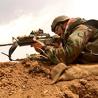 KALAK, NORTHERN IRAQ - April 4:  Kurdish Peshmergas and US Special forces are advancing from Kalak towards Khasr and  Mossul. The Northern Iraqi Lines are collapsing.  Special forces are  involved in serious fire fights and have come unde Mortar attack.  The Northern Front is open. US Special Forces are calling in airstrikes and coordinate the advance. Several journalists were caught in cross fire at the front line.  (Photo Patrick Barth/Getty Images)