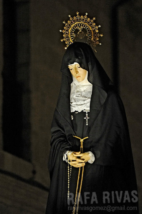 A figure of La Soledad (Virgin of Loneliness) is carried during the Virgin of Loneliness procession during the Holy Week's Easter Saturday on March 30, 2013 in the Northwestern Spanish city of Zamora.