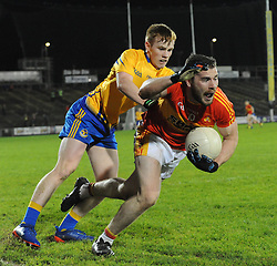 Castlebar&rsquo;s Mitchels Fergal Durkan gets tackles by Knockmore&rsquo;s Marcus Park during the county senior football final at McHale park.<br /> Pic Conor McKeown