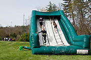 Participant climb through the inflatable obstacle course during the first part of the O'Bleness Race for a Reason Mud Run, Saturday, April 27, 2013. The course included a four-mile run up to the old Army ROTC Course at the Ridges, through the Radar Hill Trail and back to Tail Great Park across from Peden Stadium. Race for a Reason, Race 4 A Reason, Annual Events, Events, Students, Faculty & Staff