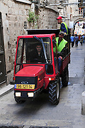 Israel, Jerusalem, Old City. Special vehicles are required by city clean up crews to negotiate the narrow alleys