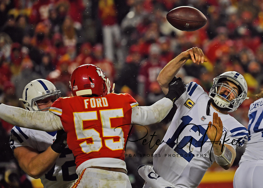 Quarterback Andrew Luck #12 of the Indianapolis Colts has the ball knocked out of his hand attempting a pass by outside linebacker Dee Ford #55 of the Kansas City Chiefs, during the second half of the AFC Divisional Round playoff game at Arrowhead Stadium in Kansas City, Missouri.