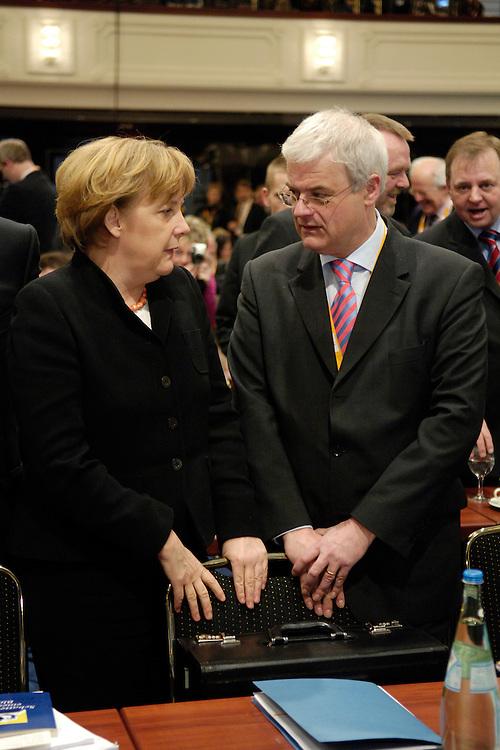 20 FEB 2006, BERLIN/GERMANY:<br /> Angela Merkel (L), CDU Bundesvorsitzende und Bundeskanzlerin, und Christoph Boehr (R), CDU Landesvorsitzender Rheinland-Pfalz und Spitzenkandidat im Landtagswahlkampf, im Gespraech, Bundesausschuss und Wertekonferenz der CDU unter dem Motto Neue Gerechtigkeit durch mehr Freiheit, Hotel Maritim<br /> IMAGE: 20060220-01-008