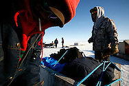 Sasa Samson, 37, and PJ, 17, tie down their gear for a seal hunt to their sled in Resolute Bay, Canada on Tuesday, June 12, 2007. Sasa, PJ, and others hunt seals for food, and their community uses every part of the seals, either eating the meat or using the hides to make warm clothes. The traditional way of life in the Resolute Bay Inuit community is being threatened by rising temperatures. The dangers of global warming, which have been extensively documented by scientists, are appearing first, with rapid, drastic effects, in the Arctic regions where Inuit people make their home. Inuit communities, such as those living on Resolute Bay, have witnessed a wide variety of changes in their environment. The ice is melting sooner, depleting the seal population and leaving them unable to hunt the animals for as long. Other changes include seeing species of birds and insects (such as cockroaches and mosquitoes) which they have never encountered before. The Inuit actually lack words in their local languages to describe the creatures they have begun to see.