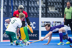 Canterbury's James Oates see his shot blocked by Andrew Ross of Sevenoaks. Canterbury v Sevenoaks - Men's Hockey League Finals, Lee Valley Hockey & Tennis Centre, London, UK on 23 April 2017. Photo: Simon Parker