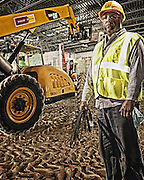 Workers portraits shot on green screen & inserted into job site photography.