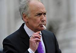 © Licensed to London News Pictures. 17 April 2013. St Paul's Cathedral London. Alistair Stewart from ITV relaxes after 3 hours of live broadcast. Funeral of Baroness Thatcher, former Conservative Prime Minister. Photo credit : MarkHemsworth/LNP