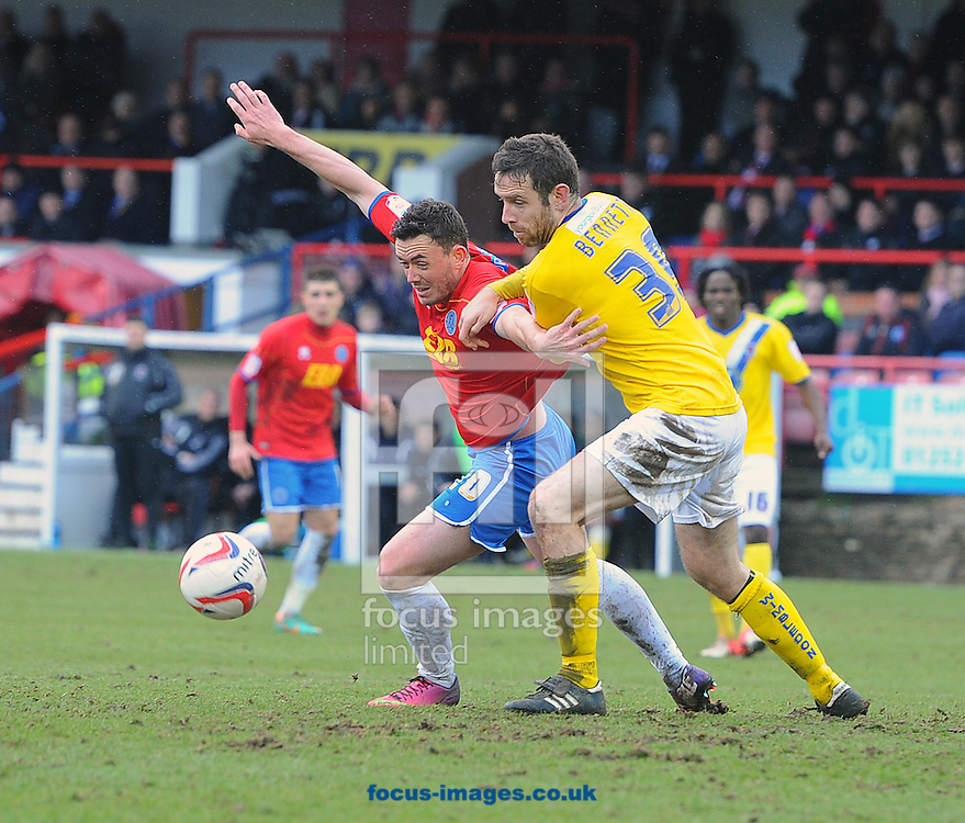 Picture by Seb Daly/Focus Images Ltd +447738 614630.16/03/2013.Craig Reid of Aldershot Town and Alan Bennett of AFC Wimbledon during the npower League 2 match at the EBB Stadium, Aldershot.