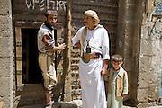 A Yemeni man wears a jambiya (traditional dagger) on his waist in Sanaa, Yemen.