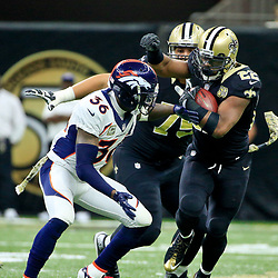 Nov 13, 2016; New Orleans, LA, USA;  New Orleans Saints running back Mark Ingram (22) is tackled by Denver Broncos cornerback Kayvon Webster (36) during the first half of a game at the Mercedes-Benz Superdome. Mandatory Credit: Derick E. Hingle-USA TODAY Sports
