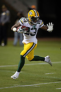 Green Bay Packers rookie cornerback Jaire Alexander (23) straight arms a defender after intercepting a second quarter pass that gives the Packers the ball at their own 7 yard line and stopping a deep Raiders drive during the 2018 NFL preseason week 3 football game against the Oakland Raiders on Friday, Aug. 24, 2018 in Oakland, Calif. The Raiders won the game 13-6. (©Paul Anthony Spinelli)