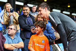 Thibaut Courtois of Chelsea jumps into the fans and poses for a photo with a young fan - Mandatory by-line: Jason Brown/JMP - 14/10/2017 - FOOTBALL - Selhurst Park - London, England - Crystal Palace v Chelsea - Premier League