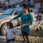"Atlanta, Georgia/Burma Refugee/Klaw Htoo with her daughters Gloria (4) and Sophia (8), as they arrive home from school in Atlanta. Klaw and her family were forced to flee Burma (also known as Myanmar) and they lived in an refugee camp in Thailand for nine years. Klaw arrived in the U.S. in 2007 alone with her oldest daughter, she was pregnant with Gloria. Her husband was not able to join her, and today he is still living in a camp in Thailand while he waits to be reunited with his family in the U.S. The IRC in Atlanta provided Klaw and her girls with a place to live and helped Klaw learn English, and find daycare so she could work. Eventually Klaw was hired as a case aide with the IRC in Atlanta. ?I liked to share my story with them and I interacted with the clients. I would give them details on how to live in the U.S.,? said Klaw. ""Life in America is tough but better than in my country because if I compare there is no way to have a good education in my country. Here there are lot of resources, for myself and my kids, we can get a good education. You have freedom and everything."" After two years of working for the IRC, Klaw went to work at Emory University and the DeKalb County Department of Health to do tuberculosis screenings and provide education to the public. ?It is such a big opportunity for me to work for them,? she said. Klaw became a U.S. citizen on January 28, 2013. /UNHCR/E.Hockstein/February 2013."