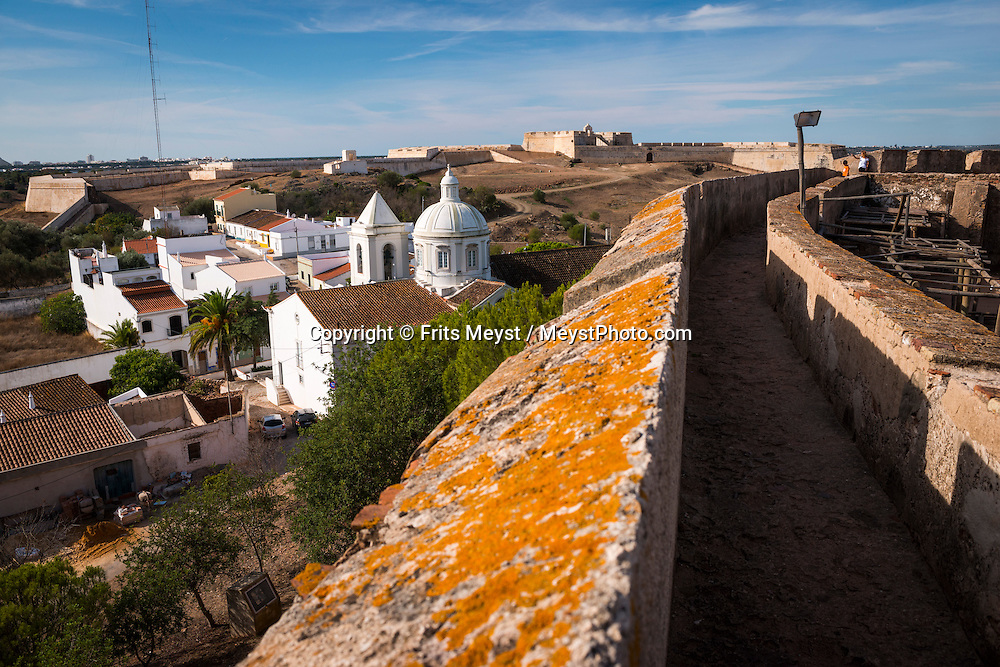 Castro Marim, Algarve, Portugal, October 2014. Castro Marim is a very old town, founded before the Roman Empire, that is surrounded by hand-harvested sea salt - 'salinas' - and a Natural Park protected by 1982's Ramsar Convention. Its castle belonged to the Templary organization until the 1356. A spectacular coastline of steep sandstone cliffs borders hidden sandy beaches on the south western tip of Europe, where the Mediterranean becomes the Atlantic Ocean.  Photo by Frits Meyst / MeystPhoto.com