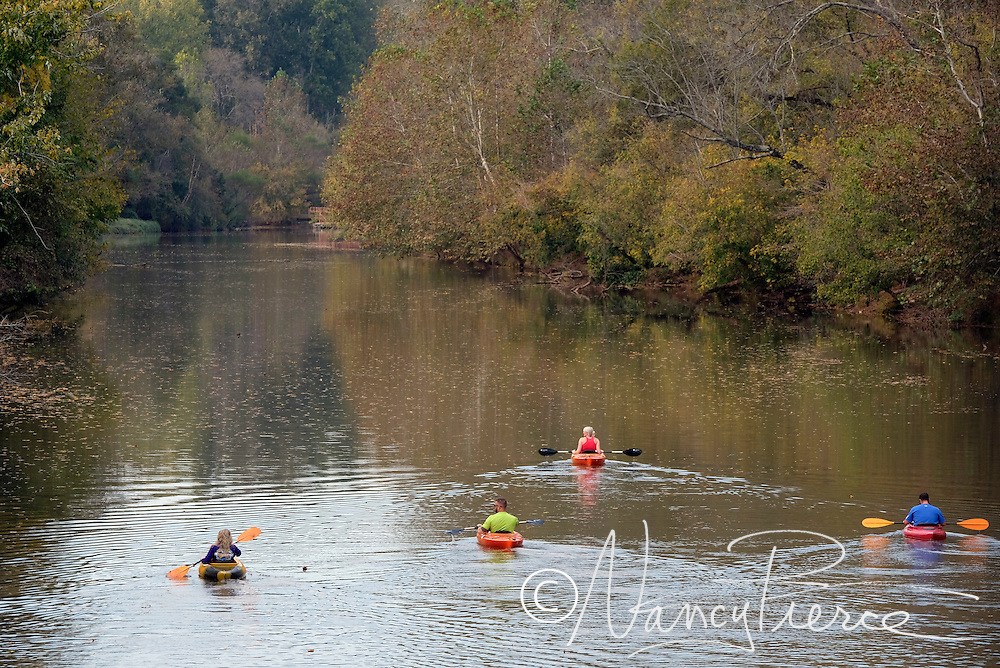 Paddlers on the South Fork River beside Goat Island in Cramerton