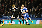 Brentford midfielder Ryan Woods accelerates past Brighton striker, Tomer Hemed (10) during the Sky Bet Championship match between Brighton and Hove Albion and Brentford at the American Express Community Stadium, Brighton and Hove, England on 5 February 2016. Photo by Geoff Penn.
