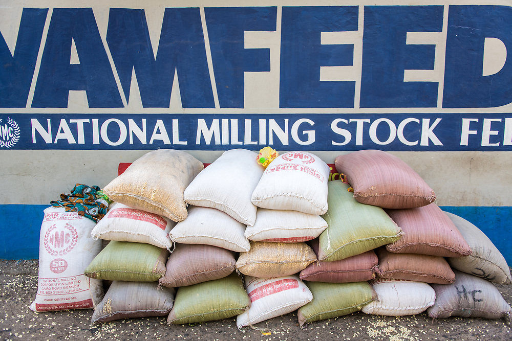 Bags of  national milling corporation limited corn and grain stock feed stacked on top of one another. Livingstone, Zambia