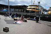 Australia, New South Wales, Sydney Harbour Aboriginal man plays a didgeridoo