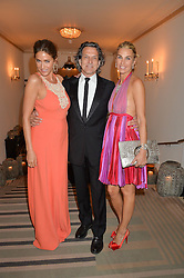 Left to right, LISA SNOWDON, STEPHEN WEBSTER and ASSIA WEBSTER at the QBF Spring Gala in aid of the Red Cross War Memorial Children's Hospital hosted by Heather Kerzner and Jeanette Calliva at Claridge's, Brook Street, London on 12th May 2015.
