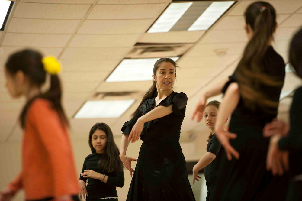 Emily Mazzotti, who has been teaching professional flamenco and belly dance for 20 years, instructs traditional flamenco dance techniques to several children in Arlington, Va., March 19, 2011.  Photo by Annie Elis