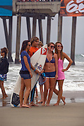 Surfer and Fans at the Pier in Huntington Beach