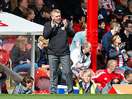 Brentford Head Coach Dean Smith during the Sky Bet Championship match between Brentford and Bristol City at Griffin Park, London<br /> Picture by Mark D Fuller/Focus Images Ltd +44 7774 216216<br /> 01/04/2017