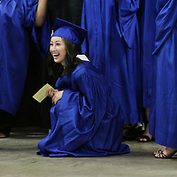 Eva Tran is all laughes as she and her classmates get ready to march out for their graduation Friday night.