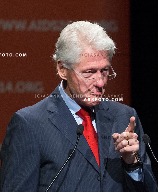 Former US President Bill Clinton makes a gesture during his speech which was earlier disrupted by about 20 protestors belonging to the Robin Hood Tax coalition during a session of the 20th International AIDS conference held in Melbourne Australia. The former American President also paid tribute to the victims of Malaysian Airlines MH17 - Asanka Brendon Ratnayake