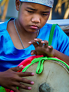 17 FEBRUARY 2018 - BAN LOT, PHETCHABURI, THAILAND: A child plays drums announcing the start of ox cart races in Ban Lat, a community about three hours south of Bangkok. The ox cart races are almost 100 years old, and date back to the reign of King Rama V. The races are run on a 100 meter long straightaway course.   PHOTO BY JACK KURTZ