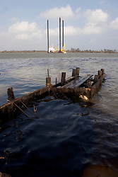 25 Sept, 2005.  Lake Calcasieu, Louisiana. Hurricane Rita aftermath. <br /> An oil platform support vessel slips out to sea as an oil spill ebbs into the channel from a ruptured pipeline close by.<br /> Photo; &copy;Charlie Varley/varleypix.com