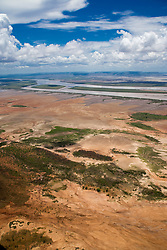 An aerial view of mangroves lining the mud flats along the Ord River in the wet season, east Kimberley.