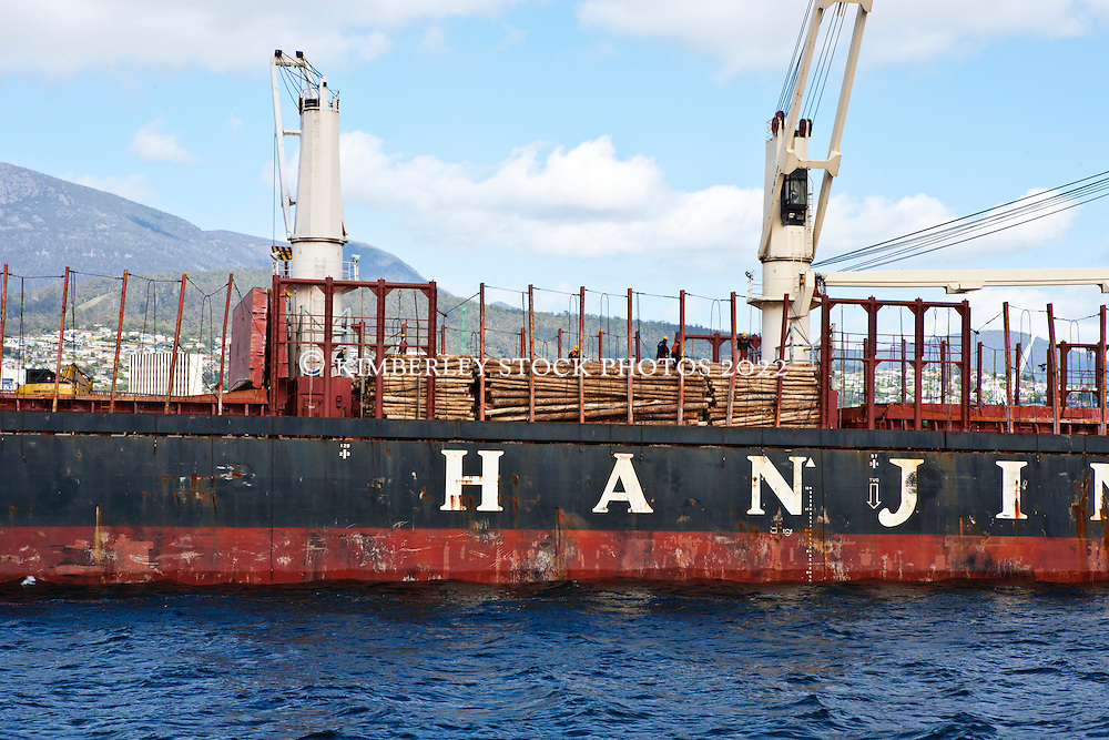 A Chinese vessel loaded with logs on the Derwent River in Hobart.