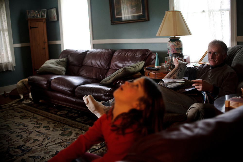 photo by Matt Roth.Wednesday, April 11, 2012..Rory Shriver sits in the living room with her grandfather Ron Shriver, Jr. ..Rory's dad, Ron Shriver grew up on a large farm house in Pleasant Valley, Maryland, a small township outside Westminster. After his lease was up, he moved back to his parent's home with his two children Rory and Miles, living temporarily in their basement before graduating from McDaniel College in May. After tossing his graduation cap, he and his children will drive cross country to meet up with his wife who has been working on her graduate degree in Alaska. ..Ron Shriver is a retired marine staff sergeant. He is also the first in his family to attend college, thanks to the New G.I. Bill. His wife, a fellow retired Marine, is finishing up graduate school in Alaska. After Ron gets his undergraduate degree from McDaniel College in May, he plans to drive to Alaska with is two children Rory, 6, and Miles, 5. For the move Ron got rid of most of his family's belongings, and after his lease was up, he and his children moved back into his parent's farmhouse.
