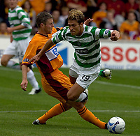 Motherwell v Celtic, Scottish Premier League, Fir Park, Motherwell.  Pic ian Stewart, Saturday 30th July 2005<br /> craigan tackles Petrov and gets booked for his trounles