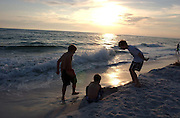 Children play at the beach in Destin, Florida.