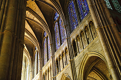 Interior of cathedral showing the cavernous interior space...Notre-Dame de Reims (Our Lady of Rheims) is the Roman Catholic cathedral of Reims France...Notre-Dame de Reims cathedral, the former Abbey of Saint-Remi, and the Palace of Tau were added to the list of UNESCO World Heritage Sites in 1991.